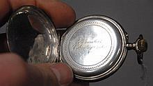 Silver open face pocket watch.