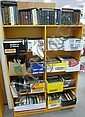 Nineteen boxes of books in orange bookcase, mostly criticism, dictionary, Samuel Johnson, and miscellaneous.
