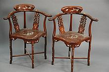 Pair of Chinese mother of pear inlaid armchairs (small piece of mother of pear missing).