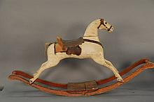 Paint decorated 19th century rocking horse with saddle, lg. 60 in.; ht. 31 in.
