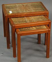 Nest of three Danish teak tile top tables, signed, hts. 14 in. - 18 in.