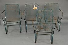 Set of four wrought iron spring chairs.