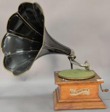 The Graphophone by Columbia, phonograph with oak case and tole horn. ht. 27