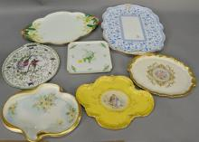 Seven piece porcelain dresser and serving trays to include Royal Crown Derby porcelain serving tray with blue and white bird design,...