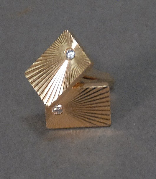 Pair of Tiffany & Co. 14K gold cufflinks each set with diamond, 19.2 grams.