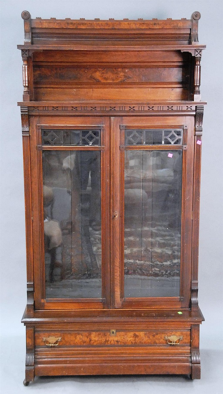 Victorian walnut and burl walnut bookcase with gallery back.