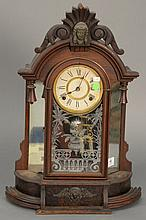 Victorian walnut clock with mirrored sides. ht. 24 in.