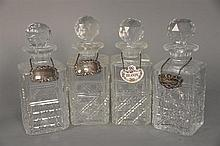 Set of four crystal decanters with stoppers. ht. 9 1/2 in.