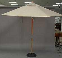 Two outdoor umbrellas with bases. ht. 99 in.