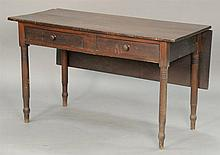 Primitive work table with one drop leaf and two drawers, circa 1830. ht. 29 in.; closed: 21