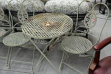 Iron outdoor table and two chairs. ht. 27 1/2 in.; dia. 23 in.