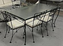 Seven piece iron set including table with glass top and six chairs.