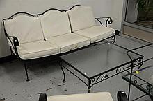 Five piece iron porch set to include a sofa, two large chairs, coffee table, and two tier cart.