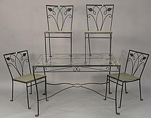 Five piece set including iron glass top table and four chairs.