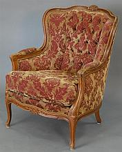 Louis XV style chair with tan and maroon upholstery.