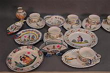 Group of nineteen Quimper to include a set of six chowder bowls with trays, two fish plates, two part dish, two charges, and two vases.