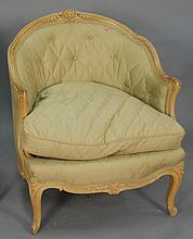 Louis XV style chair with painted frame and light green upholstery.