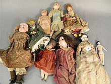 Group of nine dolls including four bisque head, Belton Doll, Salmon Halbig 1894 A.M. 2 DEP, 1896 EOD1 DEP, two porcelain head, tin h...