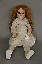 EAS German bisque head doll on new body. lg. 21 in.