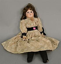 A. M. bisque head doll, shoulder head 370 on kid body/china hand. lg. 24 in.