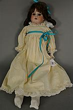 A. M. DEP bisque head doll. lg. 24 in.