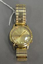 Accutron mans 14K gold wristwatch with date.