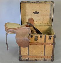 English woman's riding saddle in original trunk marked Chas. T. Wilt Chicago. trunk: ht. 29 in.; wd. 28 in.; dp. 21 in., saddle: lg...