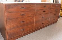 Twelve drawer walnut Mid-Century dresser with platform base, veneer. ht. 30 1/2 in.; wd. 77 1/2 in.; dp. 18 in.
