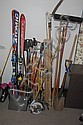 Group lot; two pairs of skis, ski boots, outdoor sled, and outdoor yard equipment.