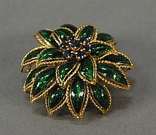 18K gold pin with green enameled petals and set with seven blue stones. 21.1 grams