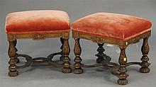 Pair of Elizabethan walnut foot stools with gardrooned legs, carved bun feet and flat molded stretchers with upholstered tops, all w...