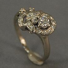 14K white gold ring with diamond approximately .25cts. and several small diamonds. 4.1 grams.