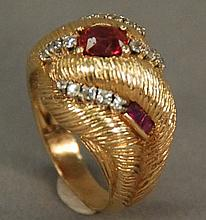 14K gold cocktail ring set with center red stone and 16 diamonds. 10.2 grams