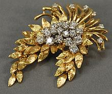 18K gold floral pin set with 25 diamonds with hinged bottom marked 18K Des in France. 28.2 grams