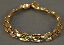 Tiffany 14K gold bracelet in original blue case and Tiffany box. 19.3 grams.
