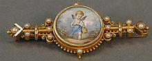 14K gold Victorian brooch mounted with hand painted porcelain plaque. 10.4 grams total weight