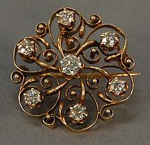 14K gold Victorian scroll pin set with seven diamonds. 6.8 grams total weight