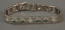 14K white gold filigree bracelet set with four trillion shaped emeralds and three small diamonds. 16 grams