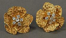 Pair of 18K gold earrings, floral design set with six diamonds each, monogrammed HB. 13.7 grams