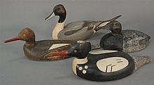 Group of four duck decoys including one Dusk's unlimited TJ Hooker and three primitive.