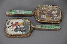 Pair of Chinese hand mirrors, each with painting on reticulated ivory, handles inlaid with carved jade, probably late 19th century. ...