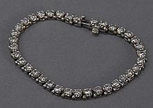 Diamond inline/tennis bracelet set in 14k gold, approximately 5cts. total.
