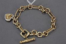 David Yurman 18k gold bracelet with heart shaped charm, signed David Yurman, 33.3 grams.