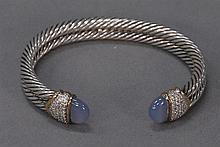 David Yurman silver double twist bracelet, tips mounted with 18k gold diamonds and cabochon stones, signed David Yurman.