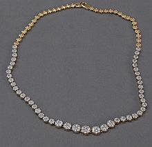 14k gold and diamond necklace, 28 grams.
