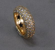 18k gold ring set with eighty two diamonds.