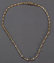 14k gold necklace set with fifteen diamonds, 23 grams.