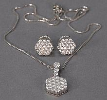 18k white gold three piece set with six sided diamond pendant set with twenty two diamonds and matching earrings set with nineteen d...