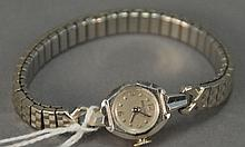18K gold ladies Bulova wristwatch.