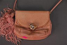 Judith Leiber purse, faded pink with snail clip.